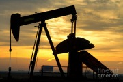 Oil well pump at sunrise