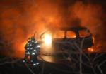 Firemen Fight an auto fire